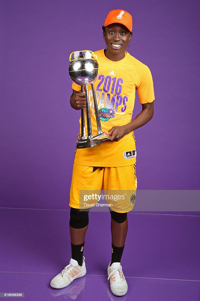 Essence Carson #17 of the Los Angeles Sparks poses for a portrait with the 2016 WNBA Championship Trophy after Game Five of the 2016 WNBA Finals against the Minnesota Lynx on October 20, 2016 at Target Center in Minneapolis, Minnesota.