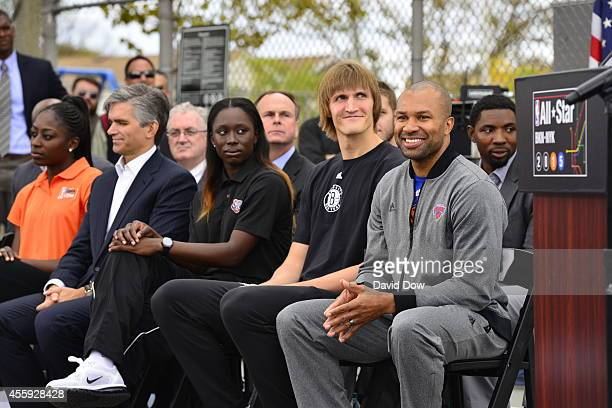 Essence Carson of the New York Liberty Andrei Kirilenko of the Brooklyn Nets and Derek Fisher head coach of the New York Knicks attend the NBA Cares...