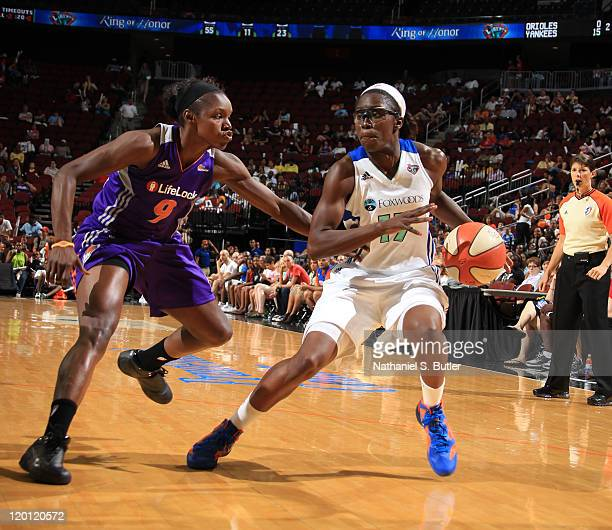 Essence Carson of the New York Liberty drives against Marie FerdinandHarris of the Phoenix Mercury during a game on July 30 2011 at the Prudential...