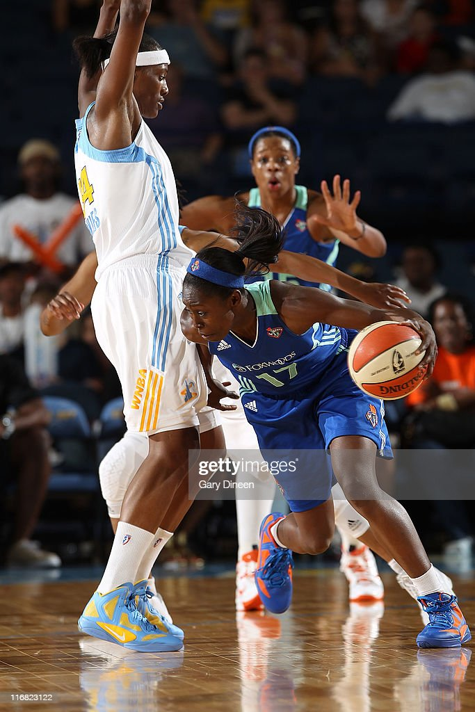 Essence Carson #17 of the New York Liberty drives the ball around Sylvia Fowles #34 of the Chicago Sky, as teammate Kia Vaughn #15 reacts in the background, during the WNBA game on June 17, 2011 at the All-State Arena in Rosemont, Illinois.