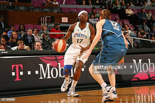 Essence Carson of the New York Liberty looks to maneuver against Laurie Koehn of the Washington Mystics during the WNBA game on May 28 2008 at...