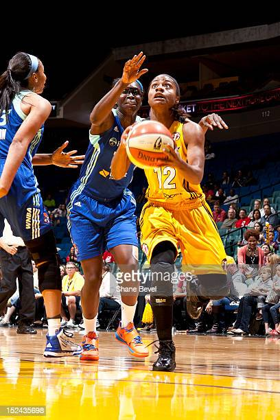 Essence Carson of the New York Liberty reaches to block a shot by Ivory Latta of the Tulsa Shock during the WNBA game on September 20 2012 at the BOK...