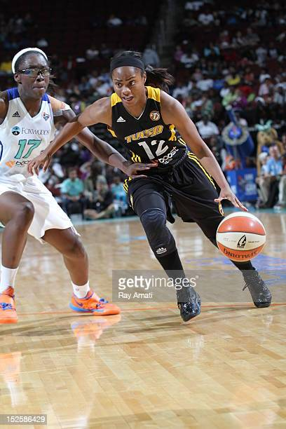 Essence Carson of the New York Liberty watches as Ivory Latta of the Tulsa Shock on September 22 2012 at the Prudential Center in Newark New Jersey...