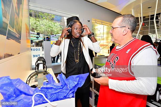 Essence Carson of the New York Liberty wears headphones during a Press Conference to announce HARMAN will become the official headphone speaker and...