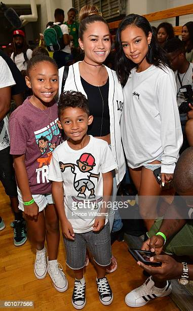 Essence Vivan Sarah Vivan Dwayne Michael Carter III and Karrueche Tran attend LudaDay Weekend Celebrity Basketball Game at Morehouse College Forbes...