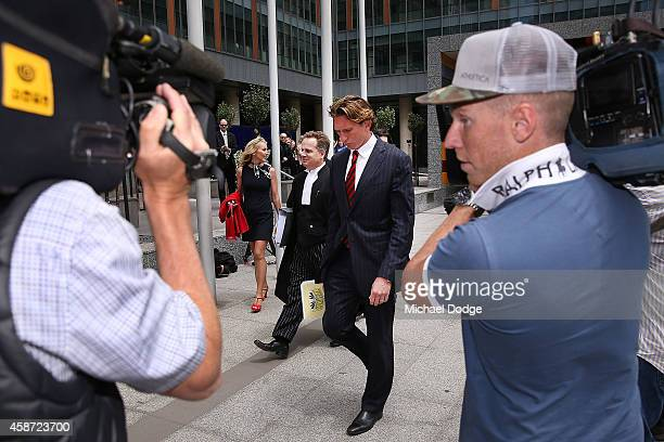 Essendon Bombers coach James Hird leaves for a break from the Melbourne Federal Court on November 10 2014 in Melbourne Australia Essendon challenged...