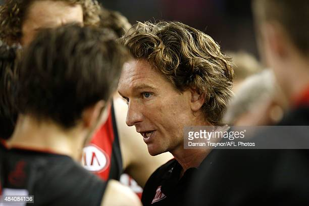 Essendon coach James Hird speaks with his players during the round 20 AFL match between the Essendon Bombers and the Adelaide Crows at Etihad Stadium...