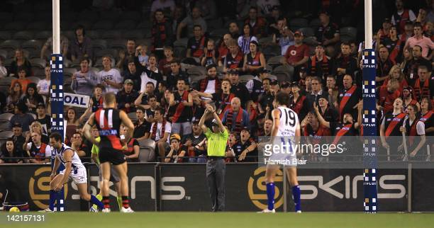Essendon fans show their disappointment as a goal is changed to a touched behind after video review during the round one AFL match between the North...