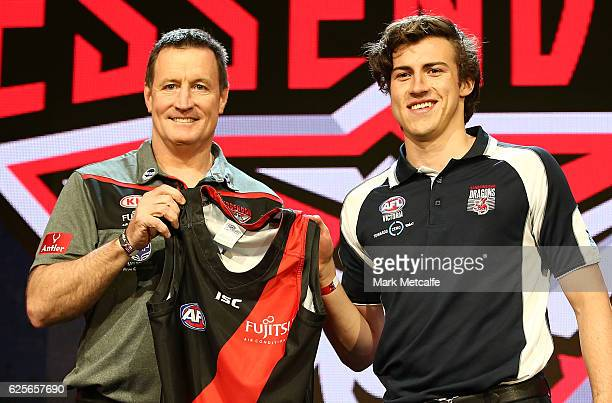 Essendon Football Club head coach John Worsfold poses for a photo with the number one draft pick Andrew Mcgrath of the Essendon Football Club during...