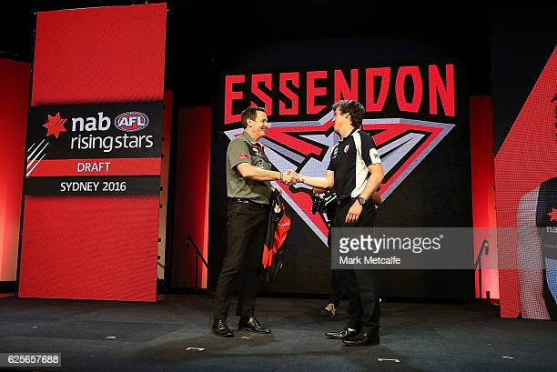 Essendon Football Club head coach John Worsfold shakes hands with the number one draft pick Andrew Mcgrath of the Essendon Football Club during the...