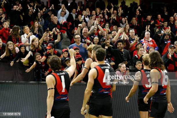 Essendon players acknowledges their fans after the round 10 AFL match between the Essendon Bombers and the North Melbourne Kangaroos at Marvel...
