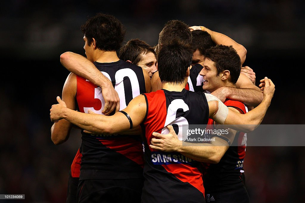 Essendon players celebrate after their win in the round 10 AFL match between the Essendon Bombers and the Western Bulldogs at Etihad Stadium on May 28, 2010 in Melbourne, Australia.
