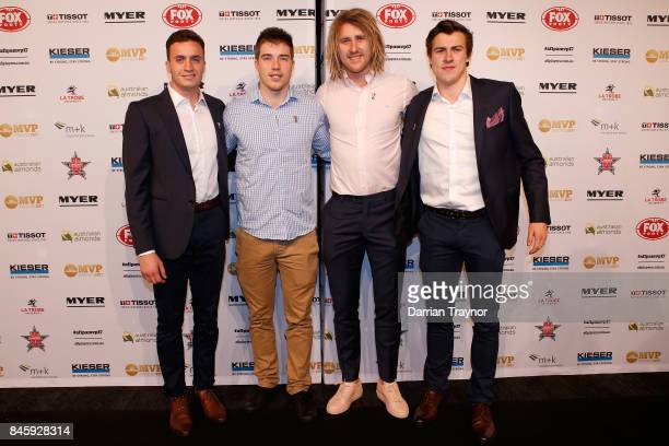 Essendon players Orazio Fantasia Zach Merrett Dyson Heppell and Andrew McGrath arrive ahead of the AFL Players' MVP Awards at Shed 14 Central Pier on...