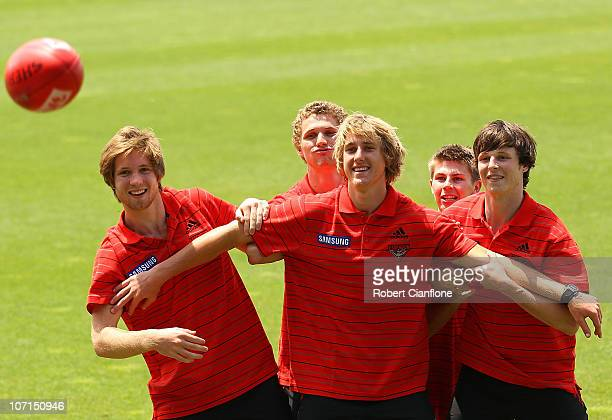 Essendon's new recruits Ariel Steinberg Luke DavisDyson HeppellMichael Ross and Alex Browne pose for the media after an Essendon Bombers AFL training...