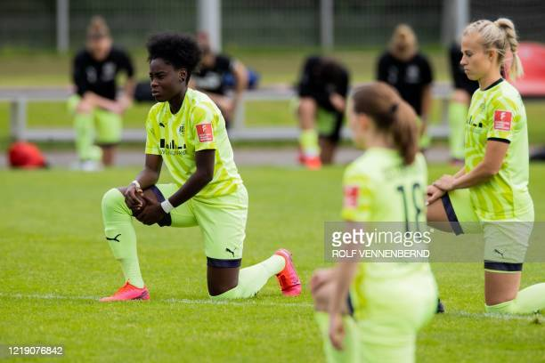 Essen's German forward Nicole Anyomi and her teammates take a knee in solidarity with protests raging across the United States over the death of...