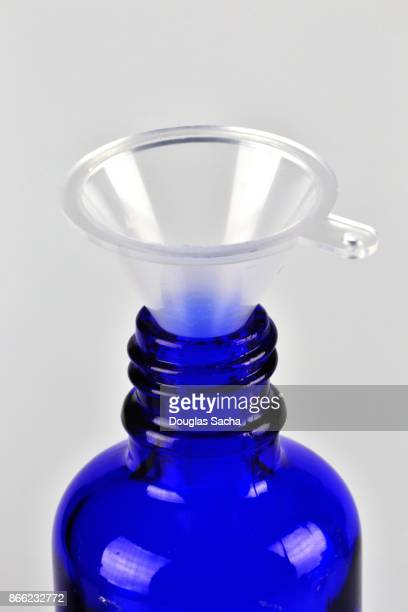 Essential Oil bottle with a filling funnel