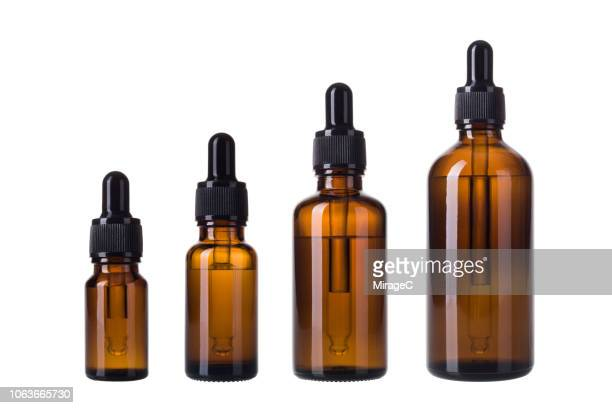 essential oil bottles - pipette stock pictures, royalty-free photos & images
