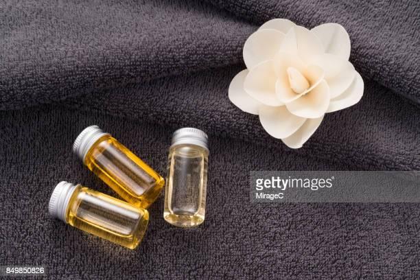 Essential Oil in Vials on Gray Towel