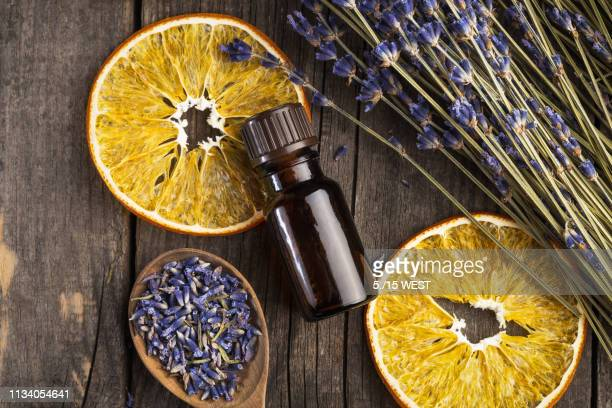 essential oil lavender and orange dry on a wooden table, top view - oil stock pictures, royalty-free photos & images
