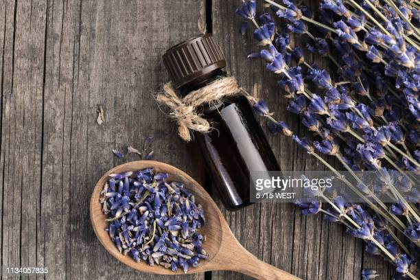 essential oil lavender dry on a wooden table, top view - aromatherapy oil stock pictures, royalty-free photos & images