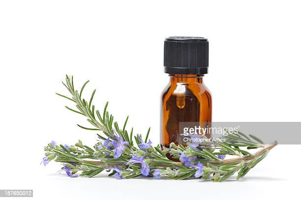 essential oil with sprigs of fresh rosemary - oil stock pictures, royalty-free photos & images