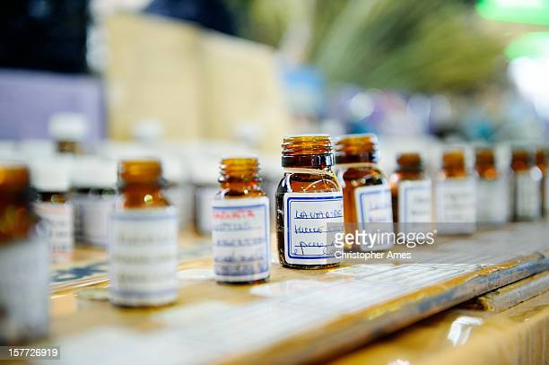 essential oils on a market stall - homeopathic medicine stock photos and pictures
