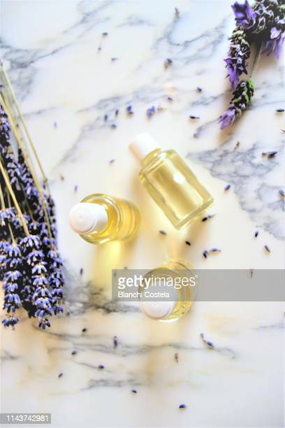essential oils on marble background - aromatherapy stock pictures, royalty-free photos & images
