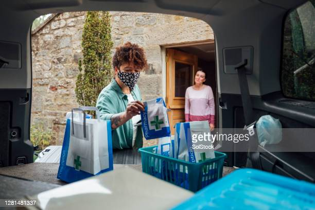 essential worker making a delivery - charity benefit stock pictures, royalty-free photos & images