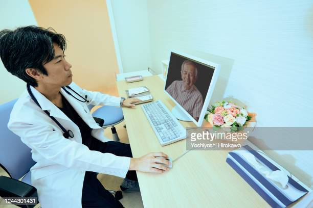 essential workers for advanced telemedicine - arteriogram stock pictures, royalty-free photos & images