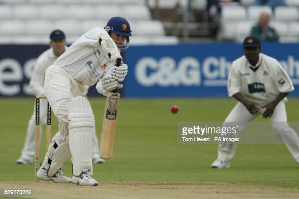 Essex batsman Andy Flower fends off a ball from Lancashire's Peter Martin during their Frizell Division 1 County Championship match at the County...