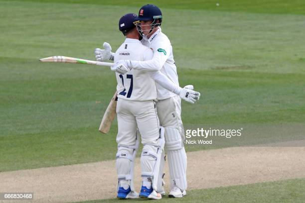 Essex batsman Daniel Lawrence receives an embrace from captain Ryan ten Doeschate having scored a century of runs at the Cloudfm County Ground on...