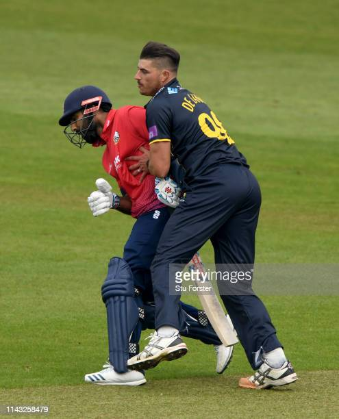 Essex batsman Varun Chopra collides with Glamorgan bowler Marchant de Lange during the Royal London One Day Cup match between Glamorgan and Essex at...