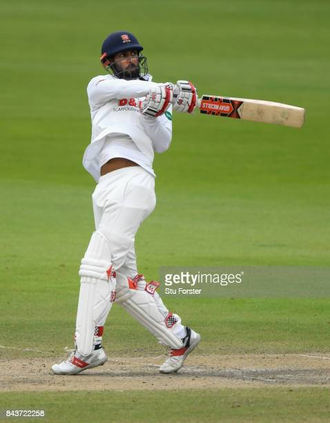 Essex batsman Varun Chopra hits out during day three of the Specsavers County Championship Division One match between Lancashire and Essex at Old...