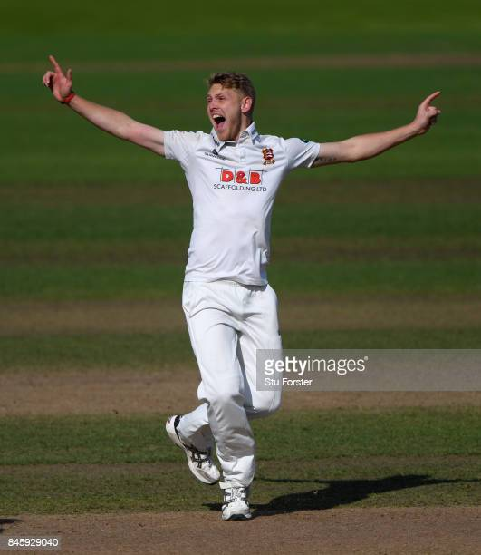 Essex bowler Jamie Porter celebrates after dismissing Jonathan Trott during day one of the Specsavers County Championship Division One match between...