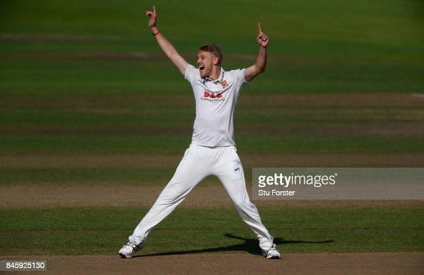 Essex bowler Jamie Porter celebrates after dismissing Sam Hain during day one of the Specsavers County Championship Division One match between...