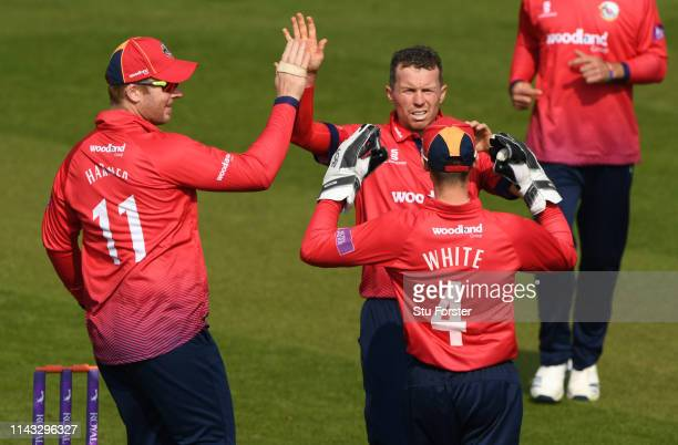 Essex bowler Peter Siddle celebrates with wicketkeeper Robbie White after the pair had combined to dismiss Billy Root during the Royal London One Day...