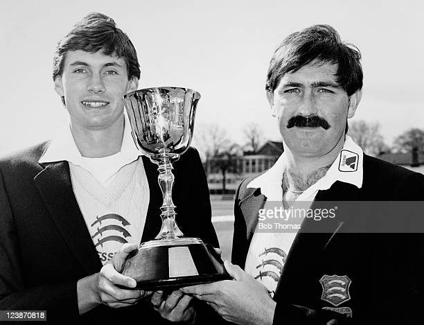 Essex cricketers Graham Gooch and Neil Foster holding the County Championship trophy which Essex won for the 1983 season, at Chelmsford on 16th April...