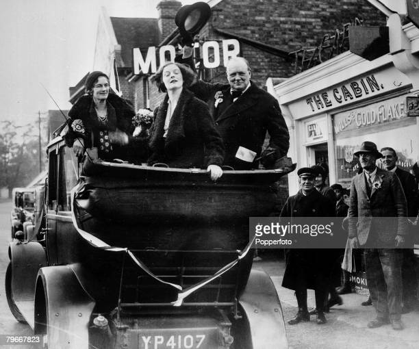 Essex England circa 1930's British politician Winston Churchill waves his hat to salute constituents as he tours the Epping constituency in an...