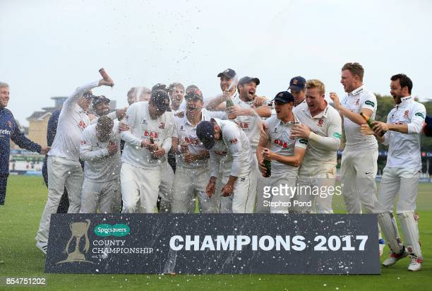 Essex players lift the County Championship trophy during day three of the Specsavers County Championship Division One match between Essex and...