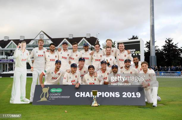 Essex pose with the Specsavers County Championship Division One Trophy during Day Four of the Specsavers County Championship Division One match...