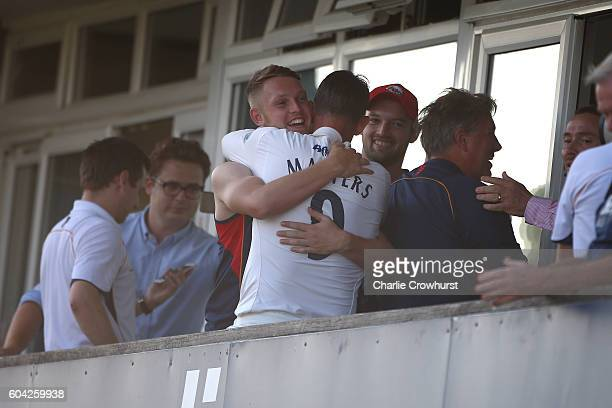 Essex's Jamie Porter and David Masters celebrate the teams promotion from the pavilion during the Specsavers County Championship division two match...