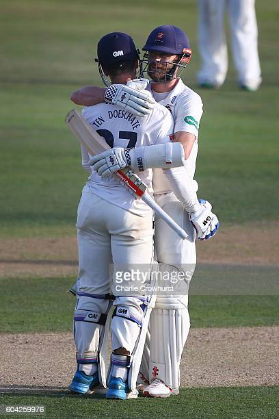 Essex's Ryan ten Doeschate and James Forster celebrate the teams promotion during the Specsavers County Championship division two match between Essex...