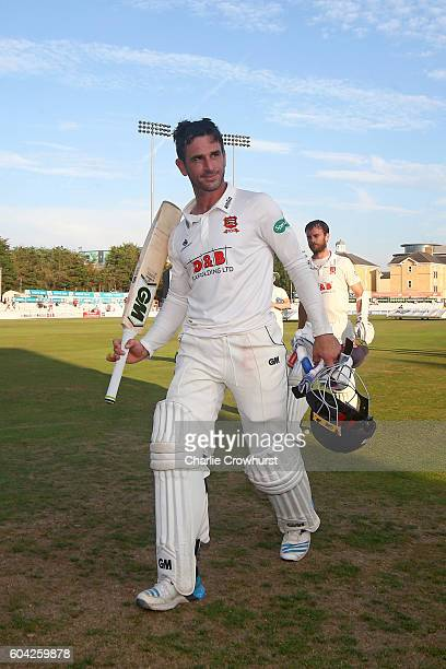Essex's Ryan ten Doeschate celebrates the teams promotion at the end of the days play during the Specsavers County Championship division two match...