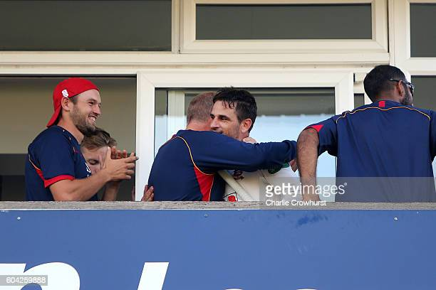 Essex's Ryan ten Doeschate celebrates with team mates after the teams promotion at the end of the days play during the Specsavers County Championship...