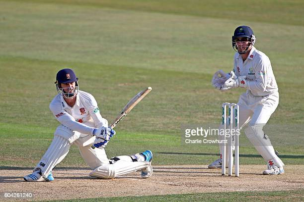 Essex's Ryan ten Doeschate hits out while Glamorgan wicket keeper Mark Wallace looks on during the Specsavers County Championship division two match...
