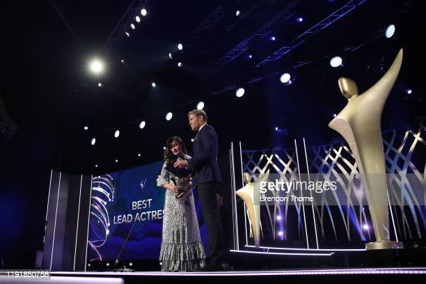 Essie Davis and Chris Brown present the AACTA Award for Best Lead Actress during the 2019 AACTA Awards Presented by Foxtel at The Star on December 04...