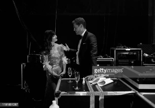 Essie Davis and Dr. Chris Brown talk backstage during the 2019 AACTA Awards Presented by Foxtel at The Star on December 04, 2019 in Sydney, Australia.