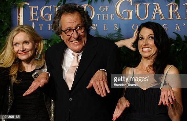 "Essie Davis, Geoffrey Rush and associate producer Katrina Peers make the gesture of a flying owl at the Australian Premiere of ""Legends Of The..."