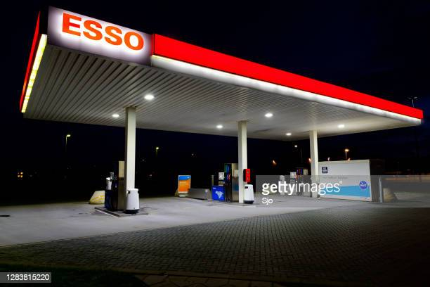 "esso self service retail gasoline station at night - ""sjoerd van der wal"" or ""sjo"" stock pictures, royalty-free photos & images"