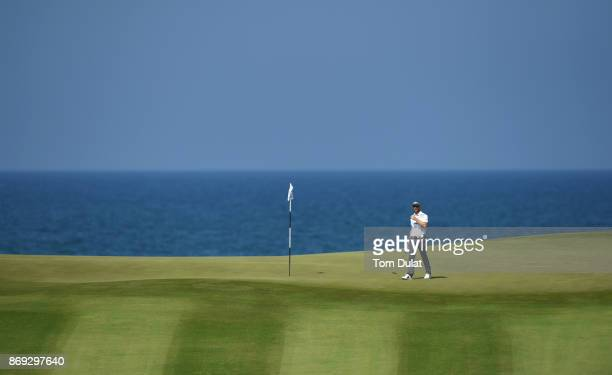 Estanislao Goya of Argentina reacts after a putt on the 11th green on Day Two of the NBO Golf Classic Grand Final European Challenge Tour at Al Mouj...